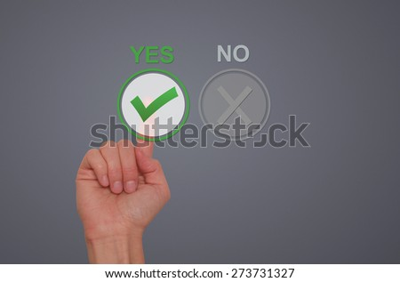 Hand Choose yes on virtual screen. Business technology concept. Isolated on grey. Stock Image. - stock photo
