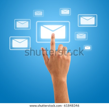 hand choosing mail symbol on blue background - stock photo