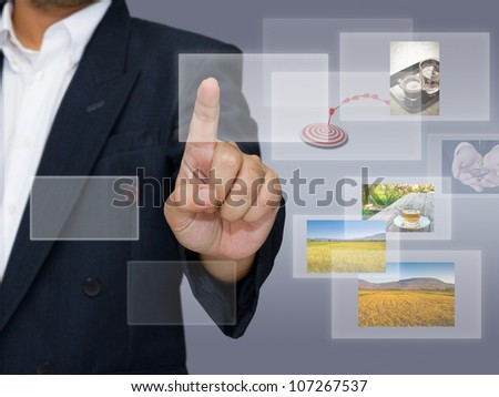 Hand choosing pictures on touchscreen - stock photo