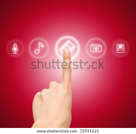 Hand choosing slide film symbol from media icons - stock photo