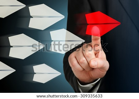 hand choosing the red plane on virtual screen - stock photo
