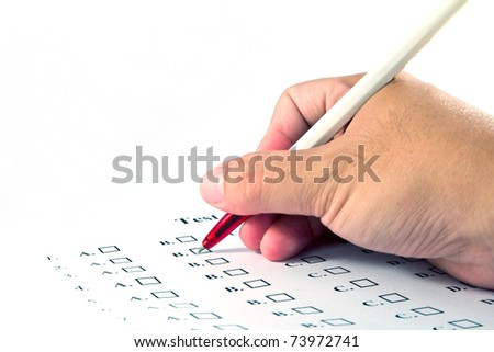 Hand choosing the test list on the examination - stock photo