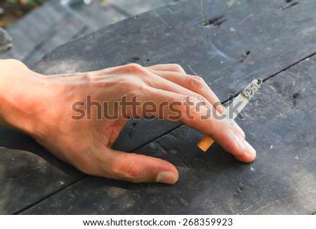 Hand cigarette - stock photo