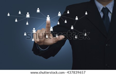 Hand click on businessman icon connection on blue background - stock photo