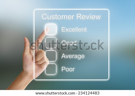 hand clicking customer review on virtual screen interface  - stock photo