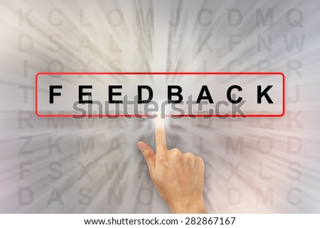 hand clicking feedback on word search puzzle - stock photo