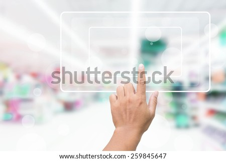 Hand Clicking On Blank Screen With Blurred Background - stock photo