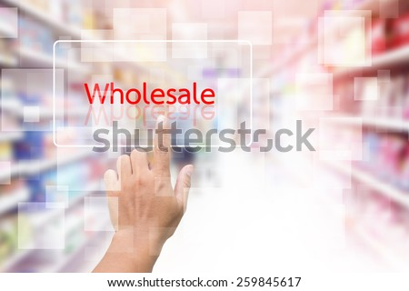 Hand Clicking On Wholesale Screen With Supermarket Shelves Blurred Background - stock photo