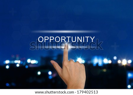 hand clicking opportunity button on a touch screen interface  - stock photo