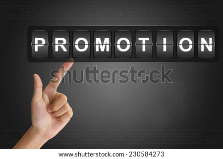 hand clicking promotion on Flip Board Display - stock photo