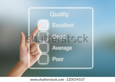 hand clicking quality feedback on virtual screen interface  - stock photo