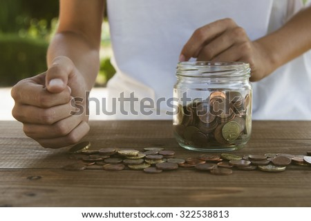 hand counting coins savings - stock photo