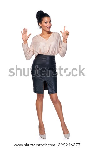 Hand counting - seven fingers. Happy mixed race african american - caucasian woman showing seven fingers standng in full length over white background - stock photo