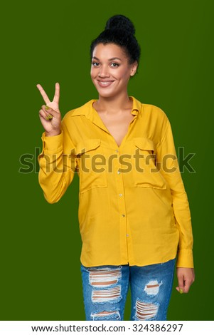 Hand counting - two fingers. Happy mixed race african american - caucasian woman showing two fingers, V sign - stock photo