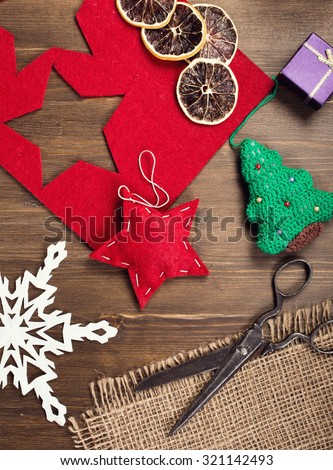 Hand crafted holiday decorations and vintage scissors top view vertical - stock photo