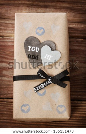 Hand crafted love appreciation present box on rustic wooden table - stock photo