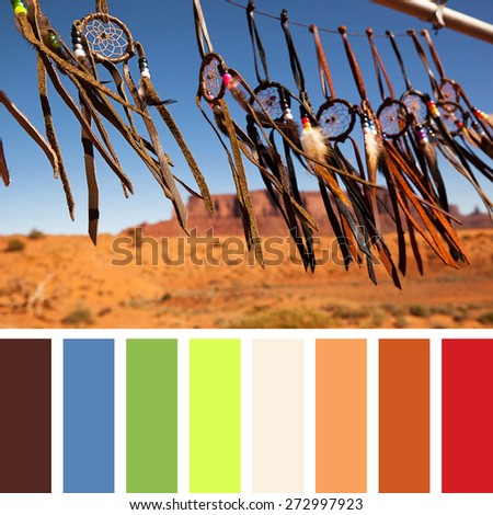 Hand crafted Native American dreamcatchers fluttering in a breeze, in Monument Valley, Utah, USA. In a colour palette with complimentary colour swatches. - stock photo