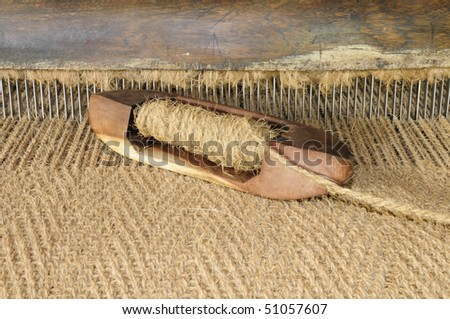 Hand crafted shuttle of an hand operated coir loom - stock photo