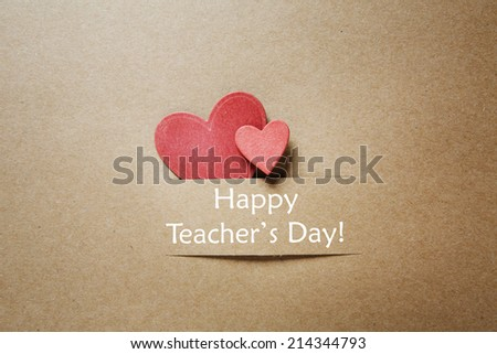 Hand crafted Teacher's Day greeting card with little red heats - stock photo