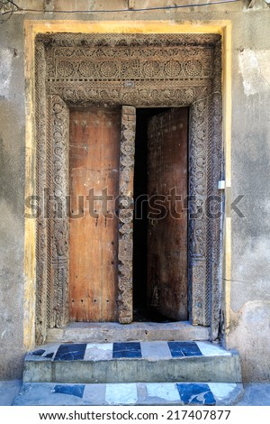 Hand crafted wooden door at Stone Town, Zanzibar - stock photo