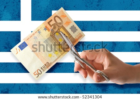Hand cut euro banknote on greek flags background - stock photo