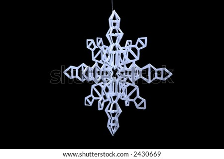 Hand cut snow flake - stock photo