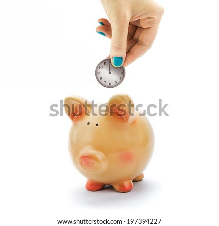 Hand depositing coin with clock dial in piggy bank - stock photo