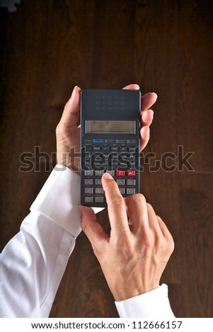hand detail with a scientific calculator in her hands - stock photo