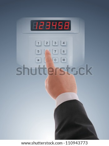 Hand  dialing on keypad using touch screen interface - stock photo