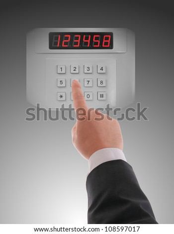 Hand dialling on keypad using touch screen interface - stock photo