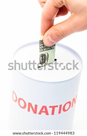 Hand donating money to charity - stock photo