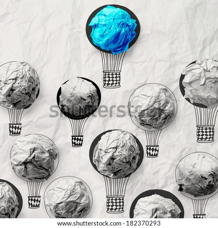 hand draw air balloons with crumpled paper ball as leadership concept  - stock photo
