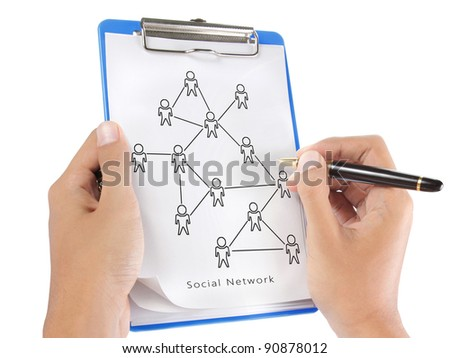 hand drawing a social network scheme on a clipboard - stock photo