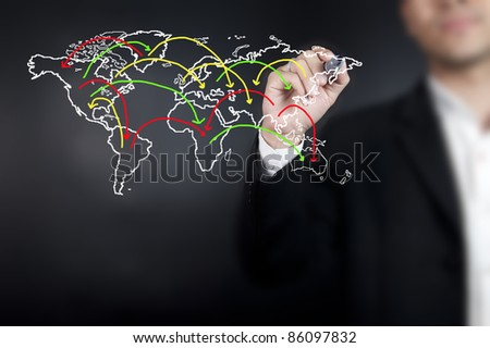 Hand drawing a social network scheme on a whiteboard - stock photo