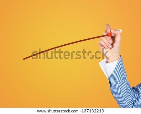 Hand drawing against yellow wall - stock photo