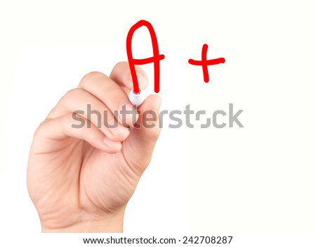 Hand drawing an A plus mark - stock photo
