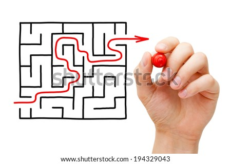 Hand drawing an red arrow going through a maze. Concept about finding a solution to a difficult task. - stock photo
