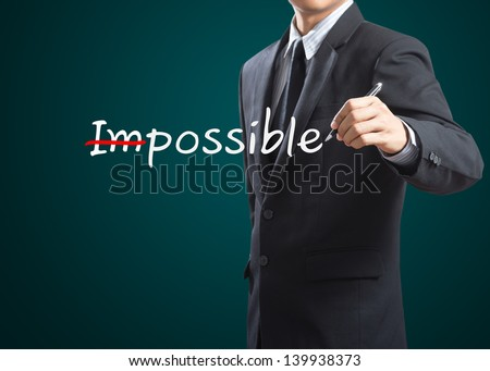 Hand drawing and changing the word impossible to i'm possible - stock photo