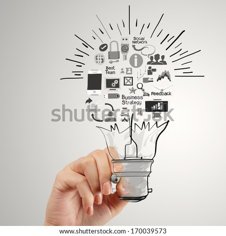 hand drawing creative business strategy with light bulb as concept - stock photo