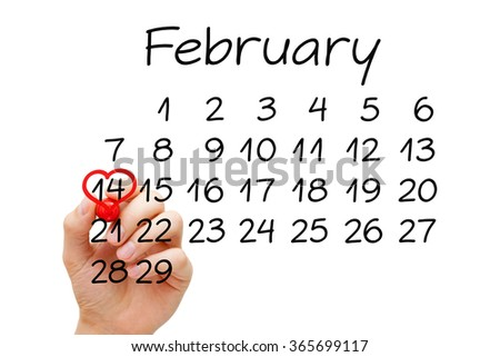 Hand drawing heart on February 14 on calendar with red marker on transparent wipe board. Valentines Day concept. - stock photo