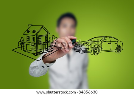 Hand drawing house and car in a whiteboard. - stock photo