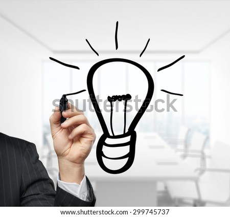 hand drawing lamp on a office background - stock photo