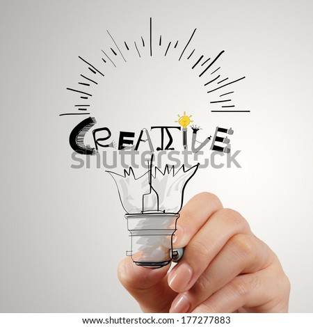 hand drawing light bulb and CREATIVE word design as concept - stock photo