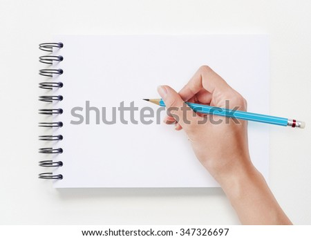 Hand drawing on white notebook background. - stock photo