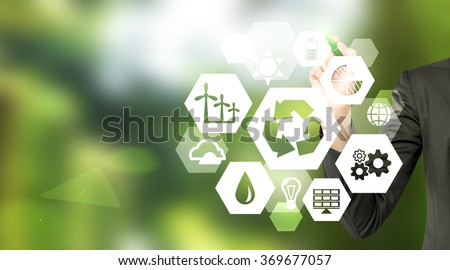 hand drawing signs of different green sources of energy in hexahedron shape, a 'reduce, reuse, recycle' sign in the centre. Blurred green background. Concept of clean environment. - stock photo