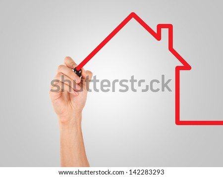 Hand drawing, sketching house with red marker. - stock photo