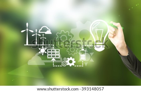 Hand drawing symbols of alternative energy sources. Blurred green background. Concept of clean environment. - stock photo
