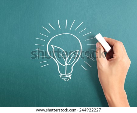 Hand drawing the light bulb  - stock photo