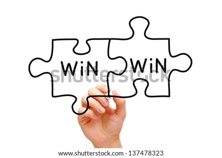 Hand drawing Win Win Puzzle Concept with black marker on transparent wipe board. - stock photo