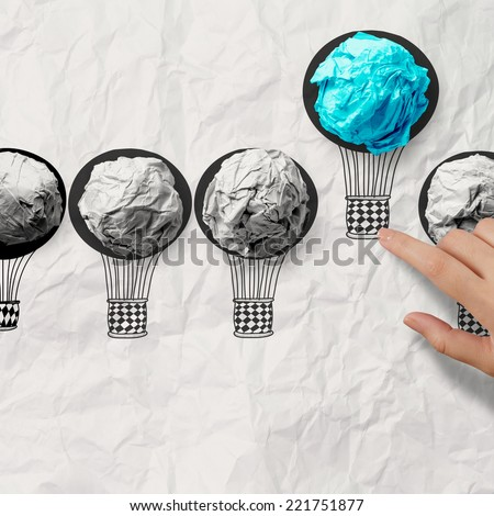 hand drawn air balloons with crumpled paper ball as leadership concept - stock photo